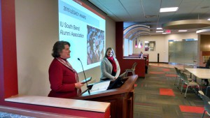 Dr. Carolyn Schult (left) receiving her award from Kelly Eberhart, Director of Alumni Affairs (right).