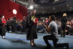 Graduate Stephanie Meyers receives proposal after ceremony. (Photo by Matt Cashore)