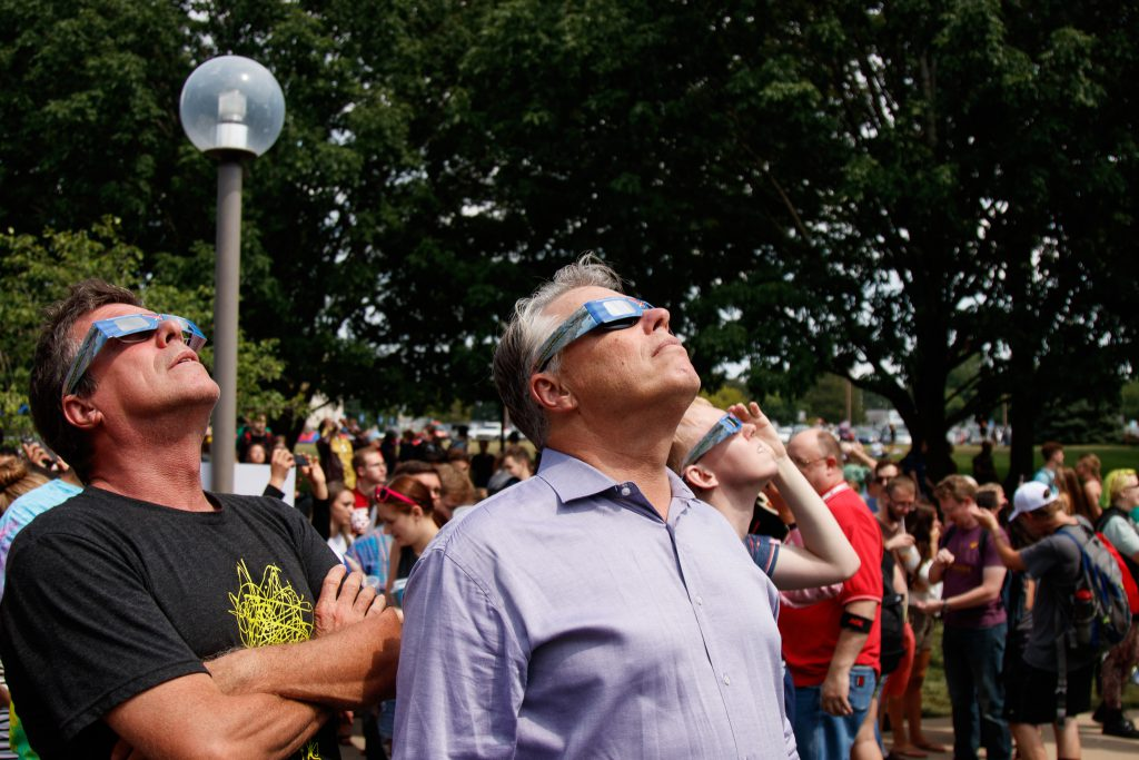 Photo of Chancellor Allison watching eclipse