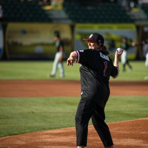 Photo of Chancellor Elrod throwing out first pitch.