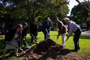 Photo of Chancellor Elrod with shovel at tree planting cermony.