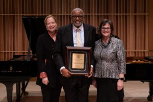 Sally Coveleskie of the Steinway organization is pictured with Marvin V. Curtis, dean of the Raclin School and Susan Elrod, chancellor of IU South Bend.